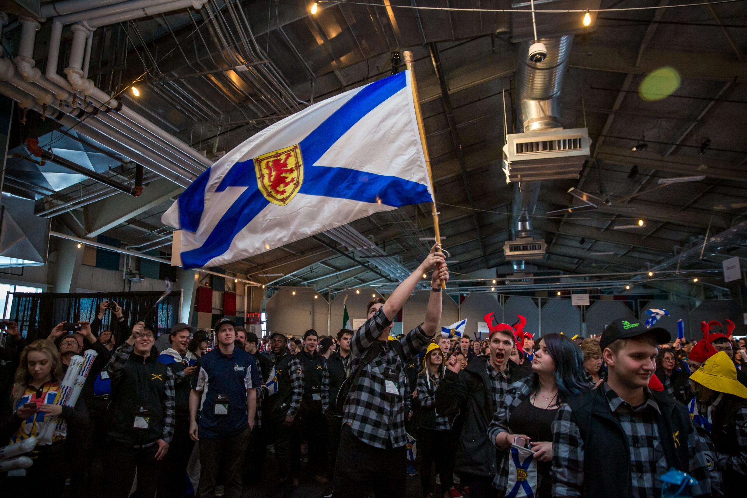 Team NS waving the Nova Scotia Flag
